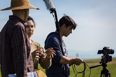 Sabah Ul-Hasan (center) works with Manny Collazo IV (right) on the first episode of BIOTA.