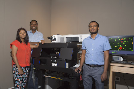 Subramaniam (right), Ghezzehei (center) and Ghosh (left) pose with the new Zeiss LSM 880 confocal microscope.