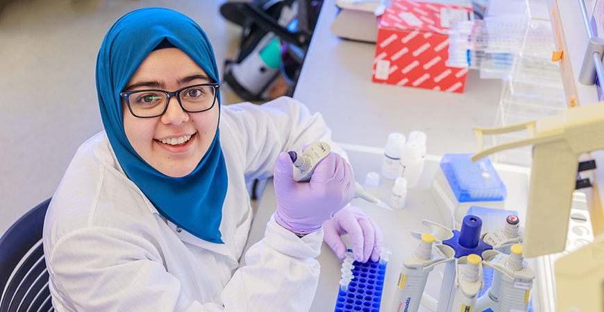 A picture of Asmaa Mohamed in a lab