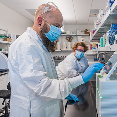 Professor Sistrom (left) and doctoral student Shari Larsen (right) in the lab.